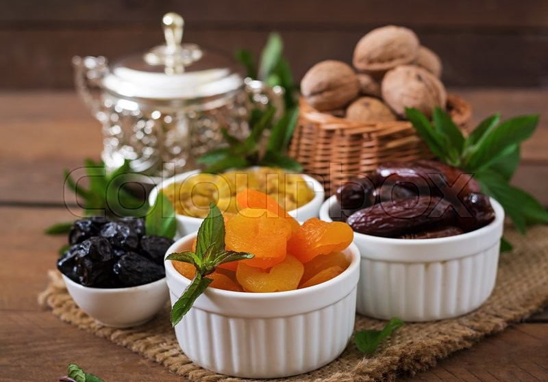 Stock image of 'Mix dried fruits (date palm fruits, prunes, dried apricots, raisins) and nuts. Ramadan (Ramazan) food.'