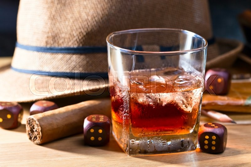 Stock image of ' whiskey with ice and cigar on wooden table'
