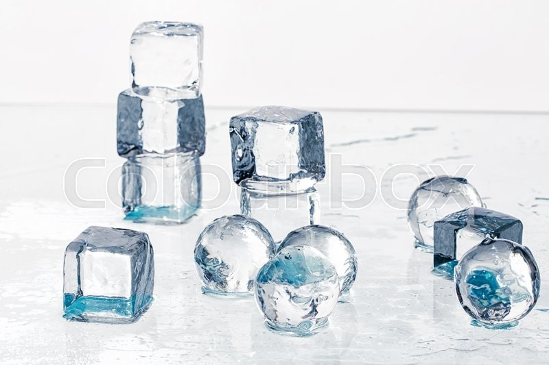 Stock image of 'Ice cubes and balls on a wet table studio shot'