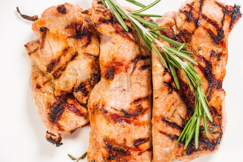 Stock image of 'Delicious grilled pork shish kebab with rosemary and herbs. Macro. Photo can be used as a whole background.'