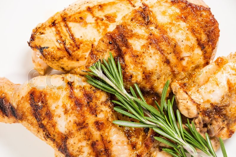 Stock image of 'Grilled chicken fillet and legs with rosemary. Macro. Photo can be used as a whole background.'