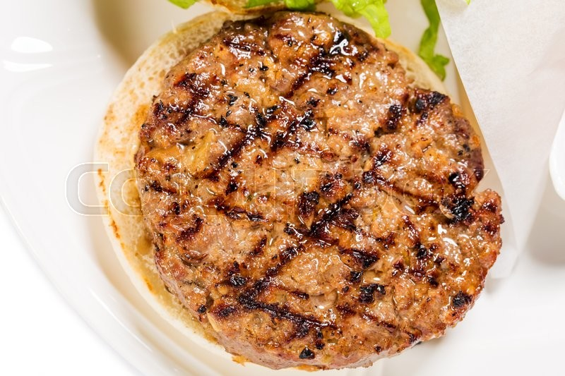 Stock image of 'Grilled beef burger with stripes closeup. Macro. Photo can be used as a whole background.'