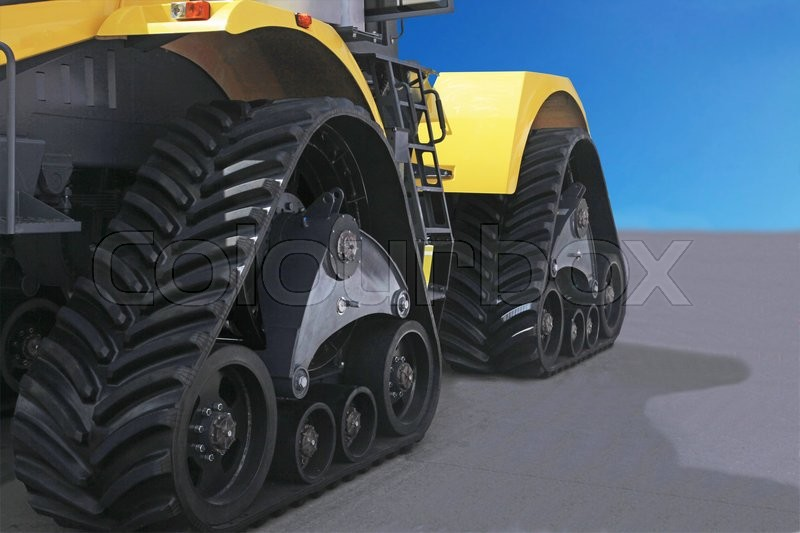 Stock image of 'rubber crampons on a tractor for construction work and agriculture'