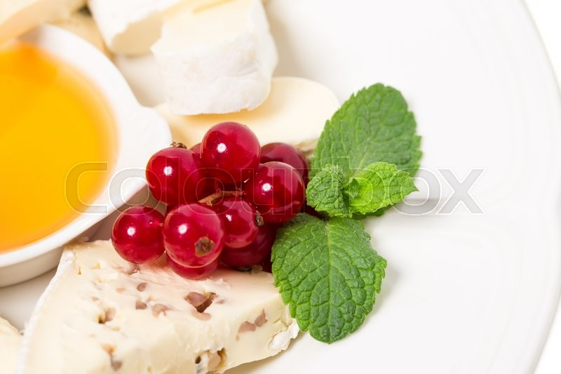 Stock image of 'Delicious cheese platter with red currant and honey. Macro. Photo can be used as a whole background.'
