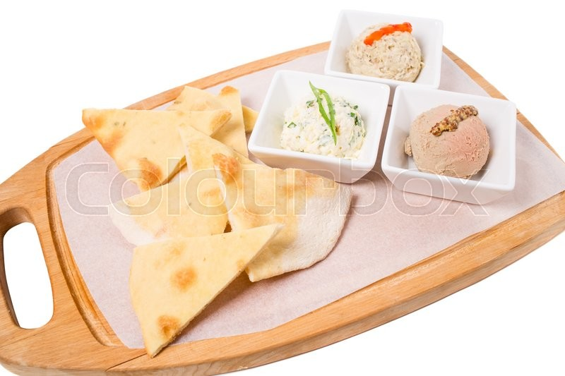 Stock image of 'Antipasto platter with italian focaccia and delicious various pates. Isolated on a white background.'