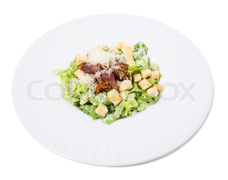 Stock image of 'Delicious caesar salad with duck leg and grated parmesan on lettuce leaves. Isolated on a white background.'