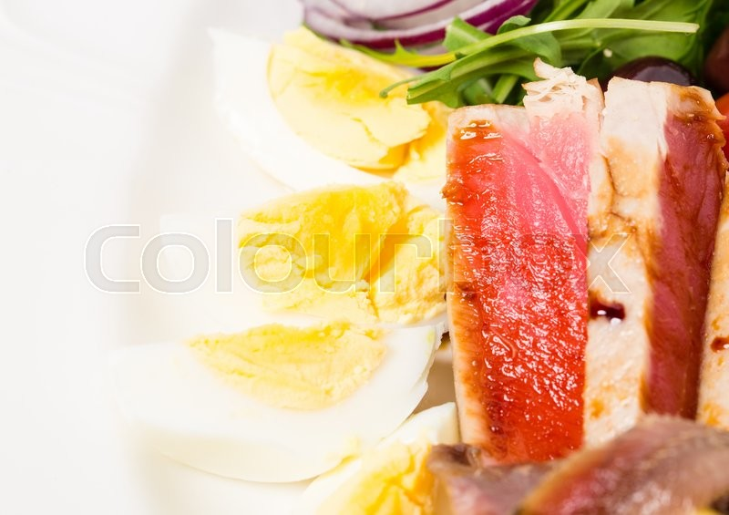 Stock image of 'Delicious nicoise salad with anchovies and chicken eggs. Macro. Photo can be used as a whole background.'