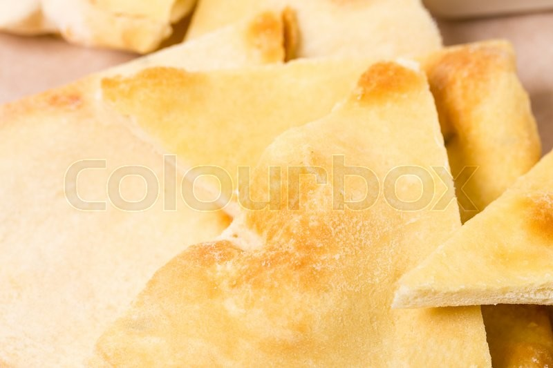 Stock image of 'Closeup of fresh italian focaccia. Macro. Photo can be used as a whole background.'
