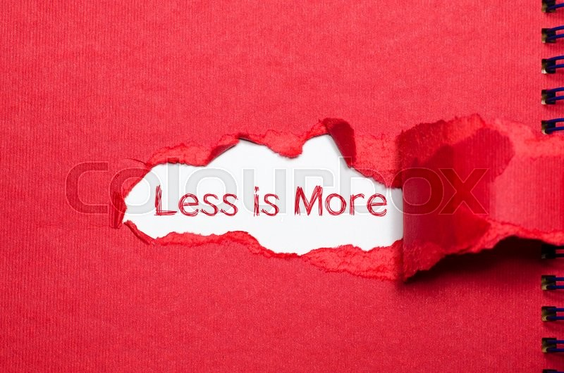 Stock image of 'The word less is more appearing behind torn paper.'