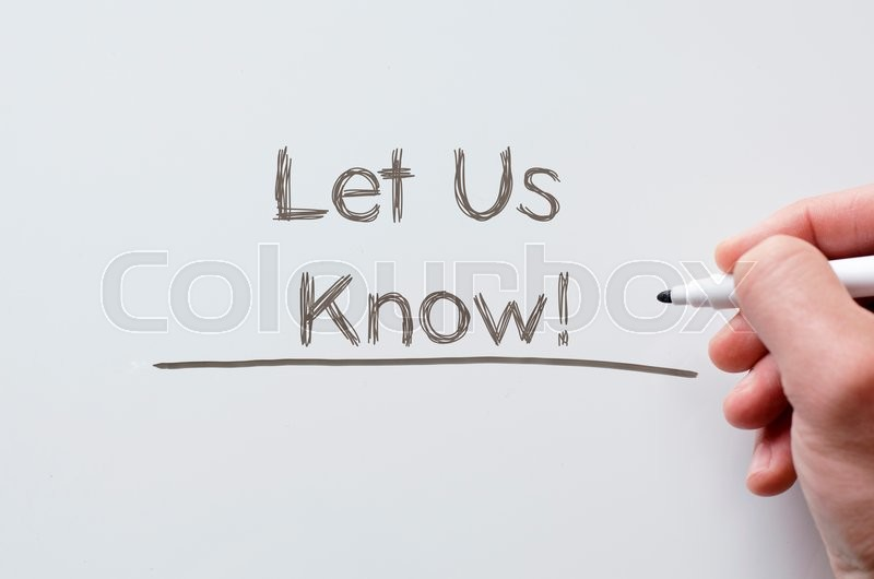 Stock image of 'Human hand writing let us know on whiteboard'