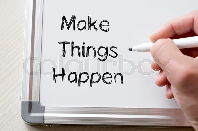 Stock image of 'Human hand writing make things happen on whiteboard'