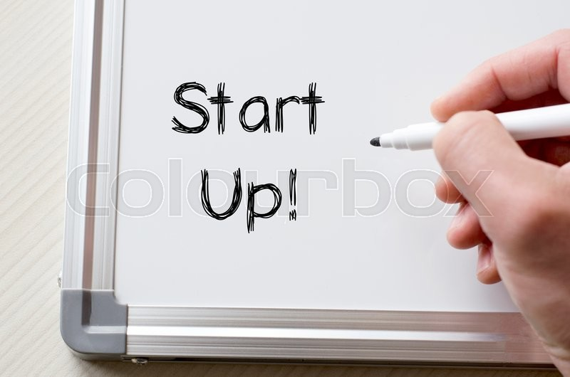 Stock image of 'Human hand writing start up on whiteboard'