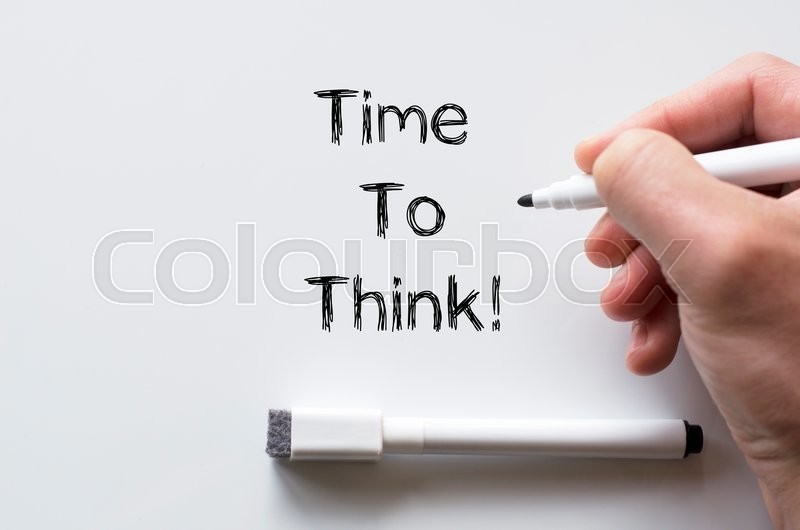 Stock image of 'Human hand writing time to think on whiteboard'