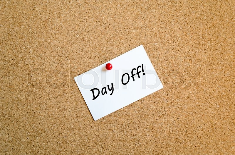 Stock image of 'Sticky Note On Cork Board Background And Day Off Text Concept'