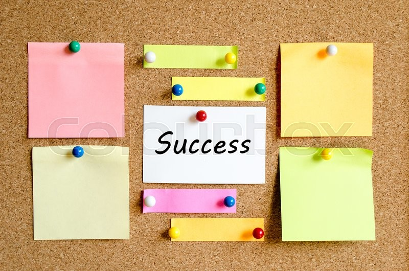 Stock image of 'Sticky Note On Cork Board Background And Success Text Concept'