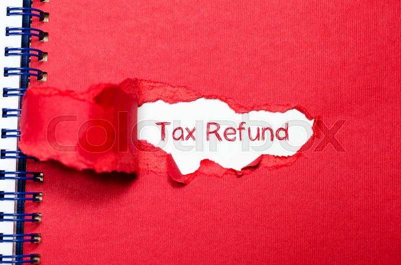 Stock image of 'The word tax refund appearing behind torn paper.'
