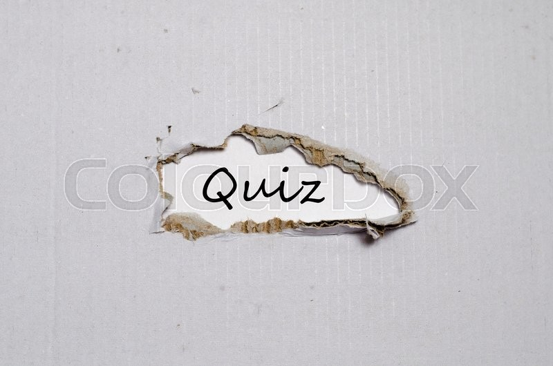 Stock image of 'The word quiz appearing behind torn paper.'