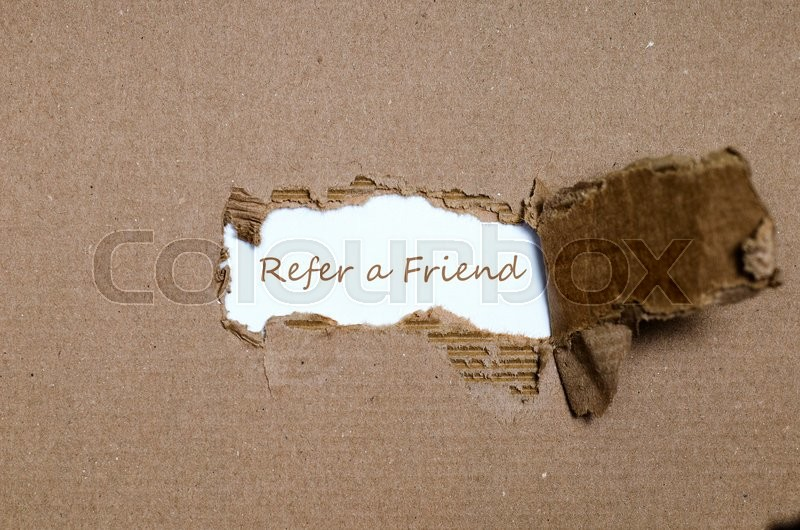 Stock image of 'The word refer a friend appearing behind torn paper.'