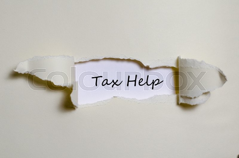 Stock image of 'The word tax help appearing behind torn paper.'