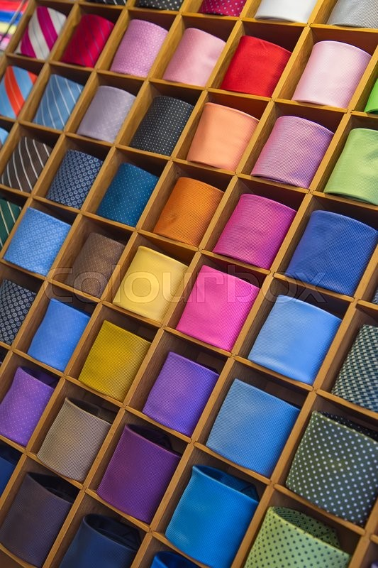 Stock image of 'Colorful tie collection in the men's shop'