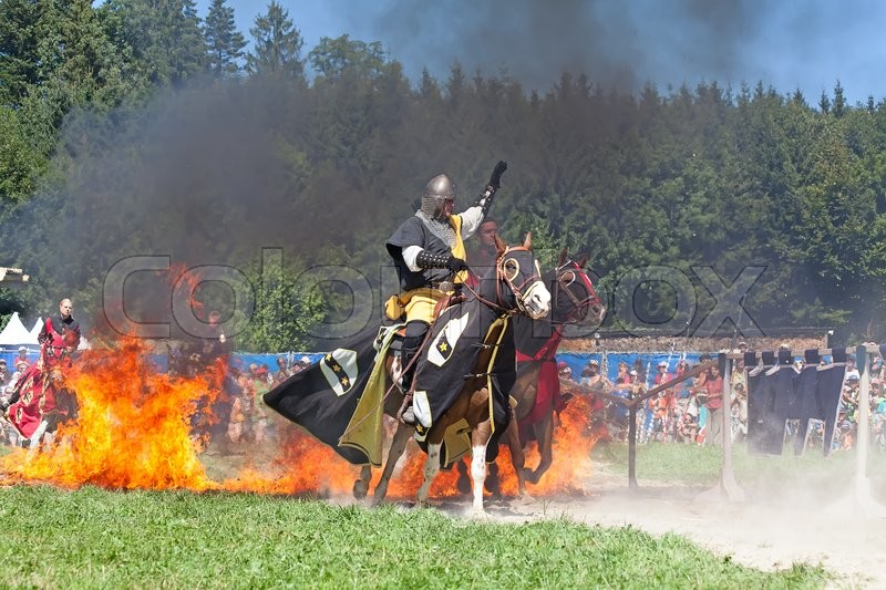 Editorial image of 'AGASUL, SWITZERLAND - AUGUST 18: Unidentified men in knight armor on the horse ready for action during tournament reconstruction near Kyburg castle on August 18, 2012 in Agasul, Canton Zurich, Switzerland.'
