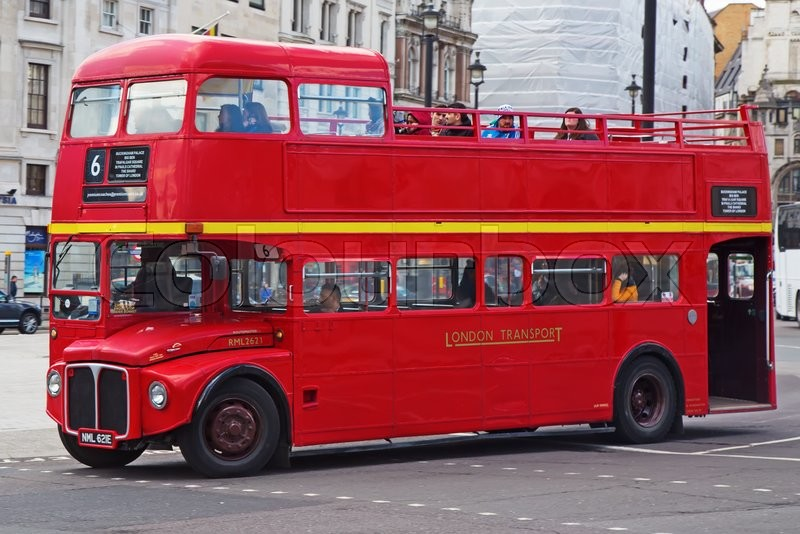 Editorial image of 'LONDON - APRIL 17: Red Double Decker Bus on the Canon street in London on April 17, 2016 in London, UK. These dobledecker bus is one of the most iconic symbol of London.'
