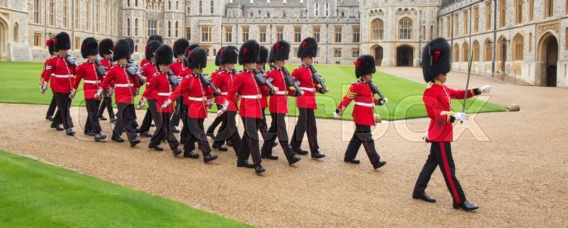 Editorial image of 'WINDSOR - APRIL 16: Unidentified men members of the royal guard during change ceremony on April 16, 2016 in Windsor, United Kingdom.'
