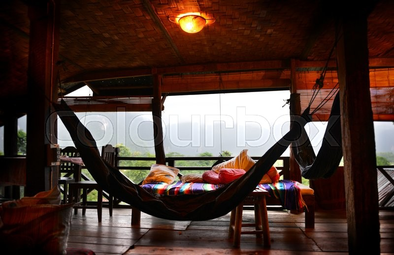 Stock image of 'relax balcony at vangvieng the countryside of laos photo indoor dark light and dark shadow the lighting is from outside low light morning'