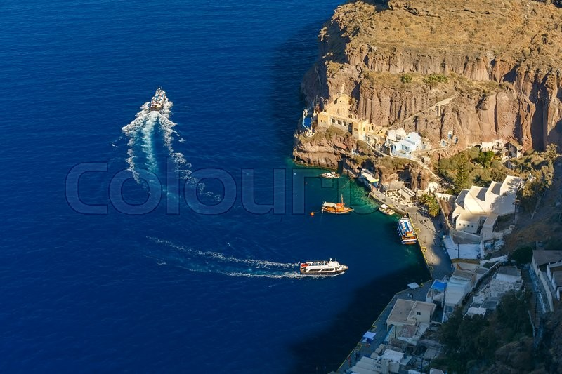 Stock image of 'Mesa Gialos, Old Port of Fira, modern capital of the Greek Aegean island, Santorini, in the sunny day, Greece'