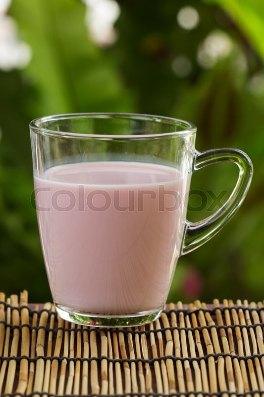Stock image of 'Glass of Strawberry flavor Milk on garden background '