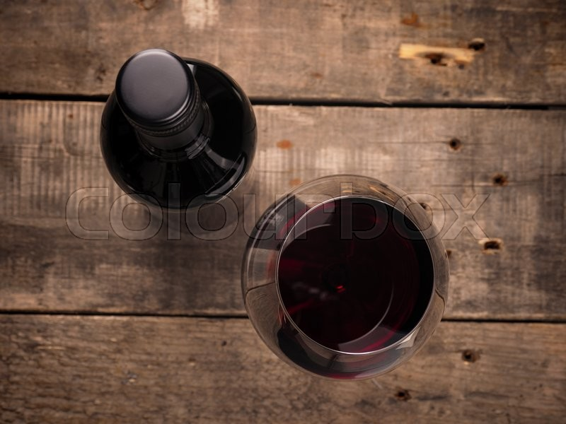 Stock image of 'Bottle and glass of red wine , view from above'