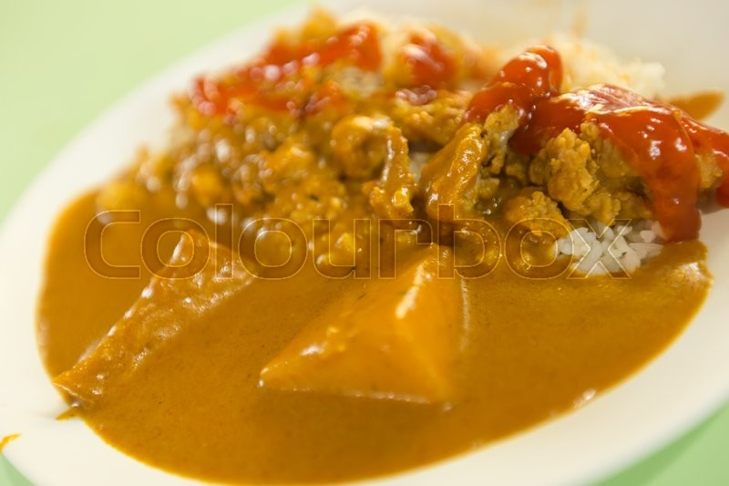 Stock image of 'Rice and curry chicken. Food is readily available in Singapore.'