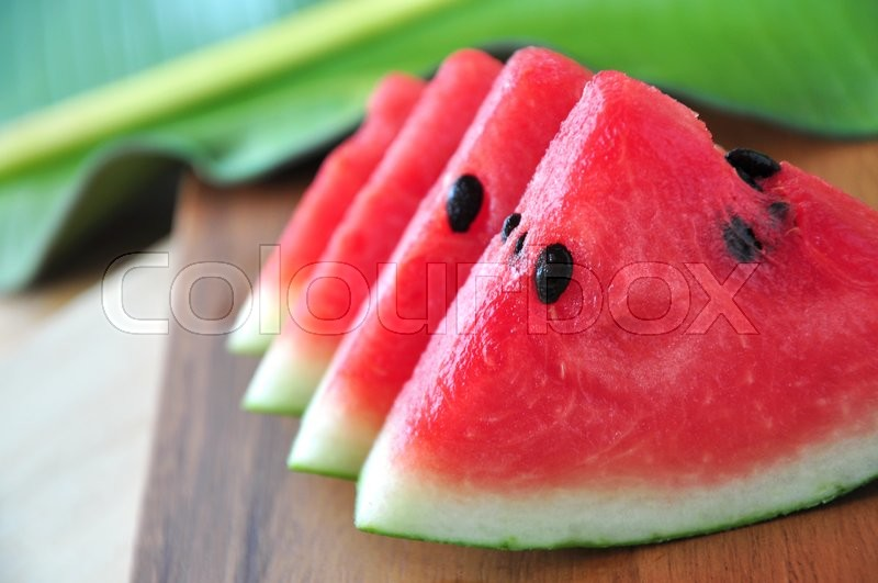 Stock image of 'Close up juicy watermelon on wooden board'