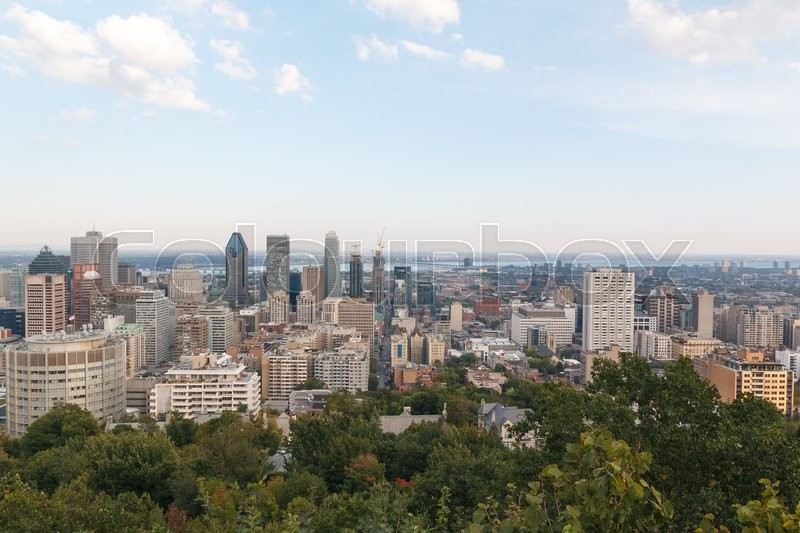 Stock image of 'Photo shows landscape view of Montreal city during autumn sunny day.'