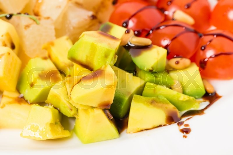 Stock image of 'Jumbo shrimp salad with avocado and mango topped with pine nuts and parmesan cheese. Macro. Photo can be used as a whole background.'