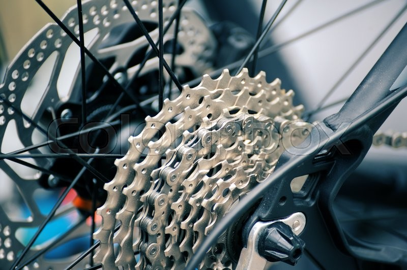 Part of bicycle close up wheel and gear, stock photo
