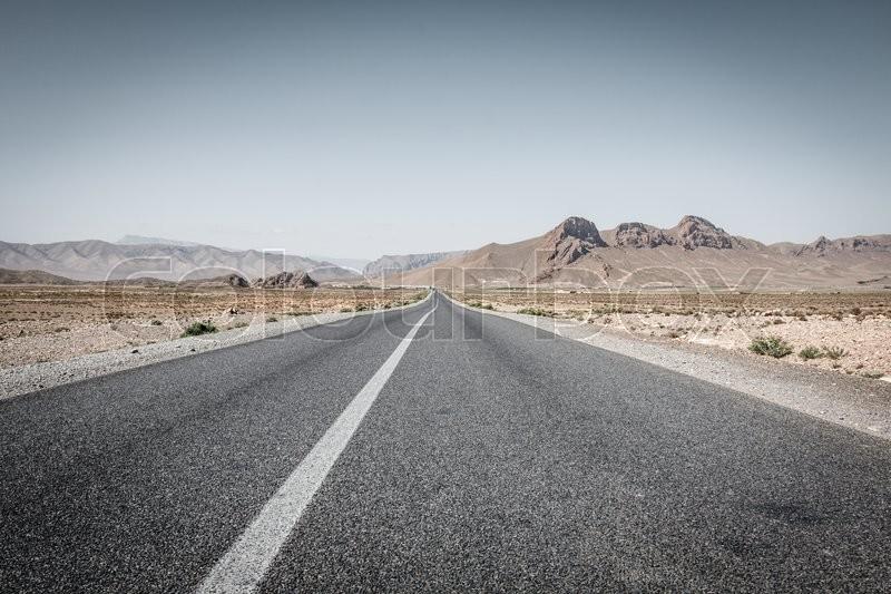 Desert road in Morocco, stock photo