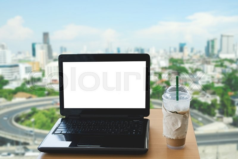 Blank screen of laptop, ice coffee cup, mock up, stock photo