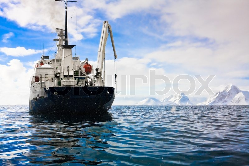 Big ship in Antarctic waters, stock photo
