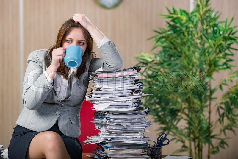 Businesswoman under stress working in the office, stock photo