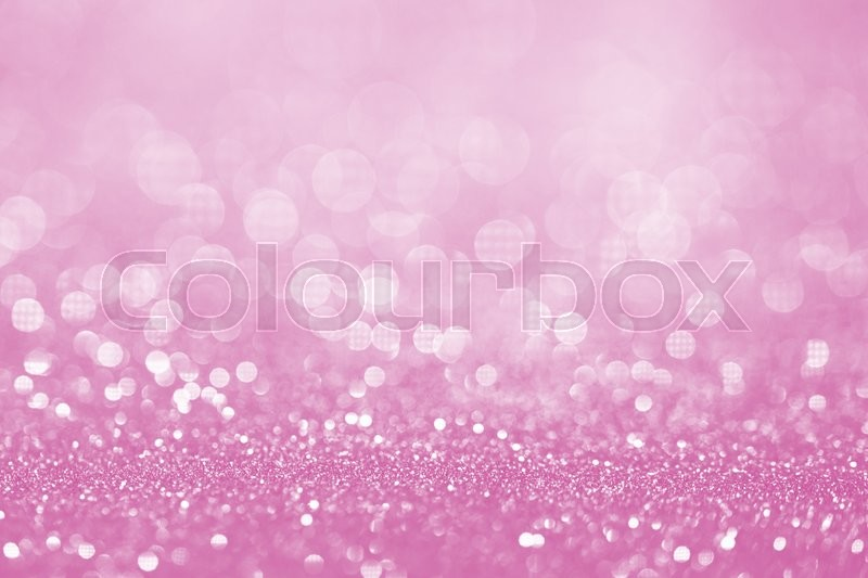 Pink glitter surface with pink light bokeh - It can be used for background for special occasions promotion campaign or product display, stock photo