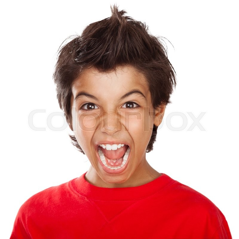 portrait of a mad boy screaming upset child with open mouth yelling