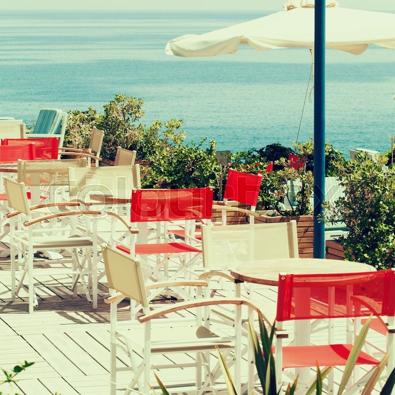 Summer coffee shop by the sea, impressions of Greece, stock photo