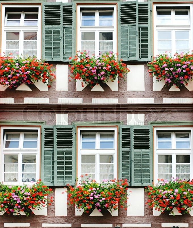 Windows with flower decoration in textured wooden wall for Window in german