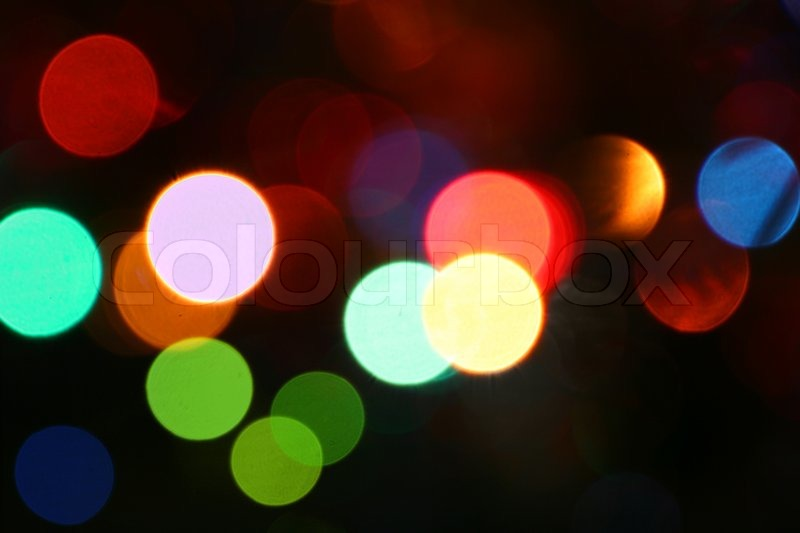 Fancy Light Effects In A Dark Background Stock Footage: Defocused Light Effects Holiday Background.