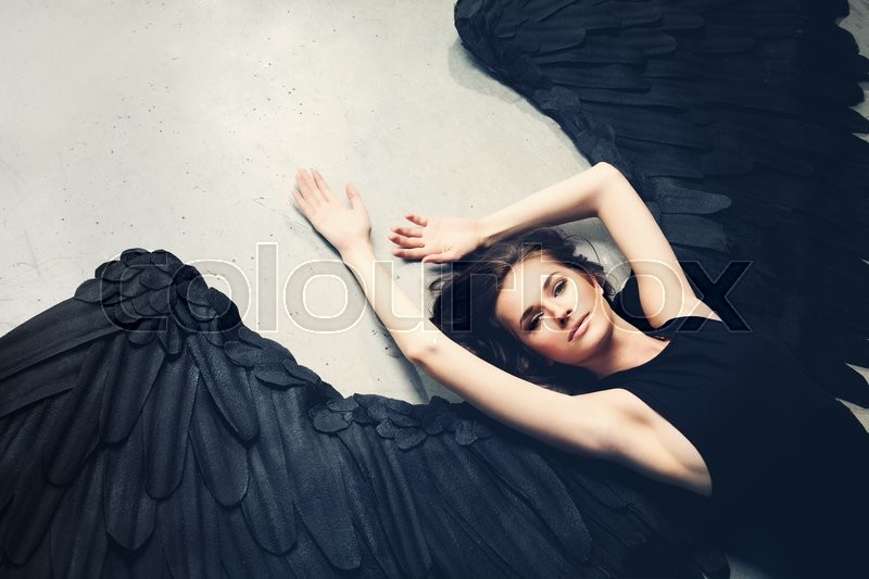 Sensuality Woman Black Angel Relaxing, stock photo