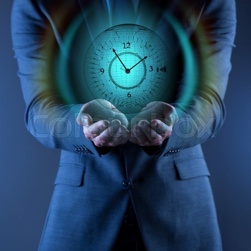 Businessman holding virtual clock in time is money concept, stock photo