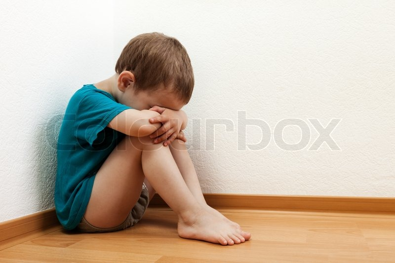 Stock image of 'Little child boy wall corner punishment standing'