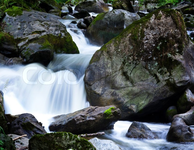 a cool stream of water and rocks in the mountains unspoiled nature stock photo colourbox. Black Bedroom Furniture Sets. Home Design Ideas