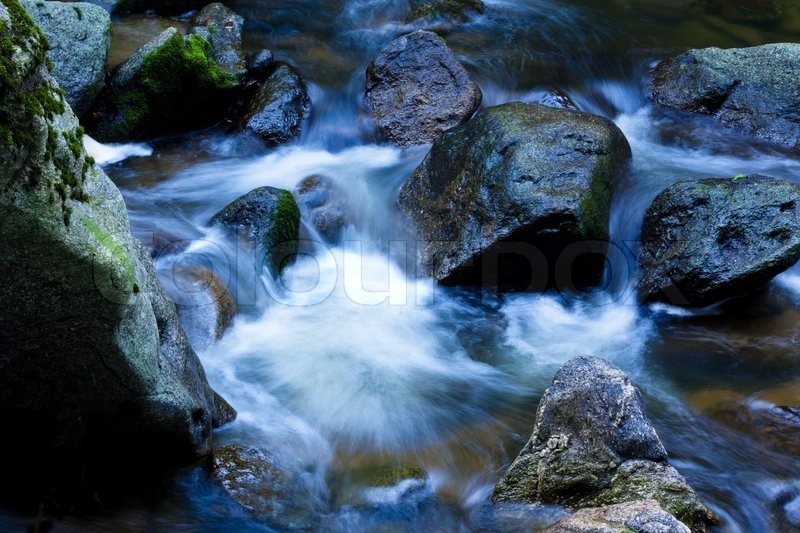 a cool stream of water and rocks in the mountains. Black Bedroom Furniture Sets. Home Design Ideas